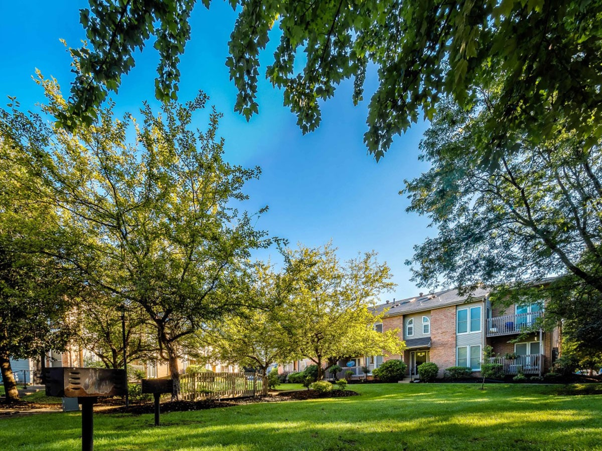 Wide view of Brookfield apartments with its well-maintained landscape and barbeque grills