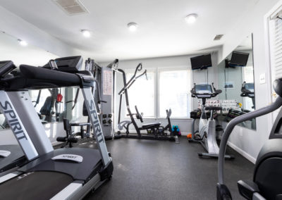 State-of-the-art fitness equipment with television screens exclusively for Brookfield apartment residents