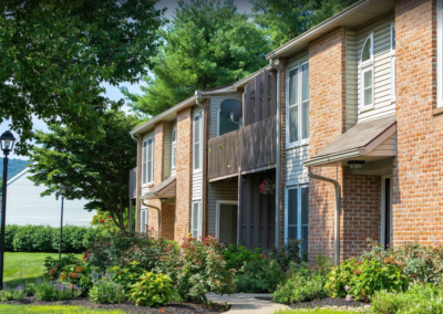 Exterior of luxurious Brookfield apartment complex with scenic landscape in Macungie, PA