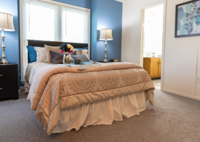 Phenomenal model bedroom with carpeted flooring and private bathroom in Brookfield apartments